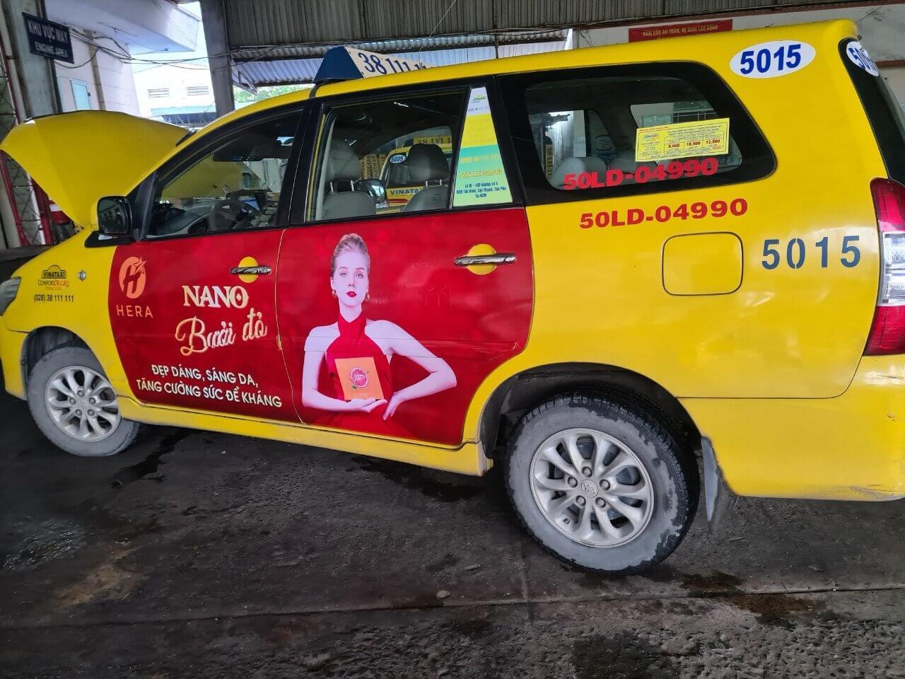 Hera nano bưởi đỏ quảng cáo dán full 4 cánh Vina taxi vàng